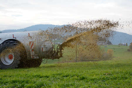 septic tank: Slurry spreading on a meadow