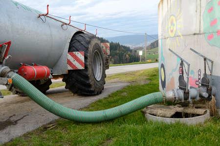 Slurry is filled in liquid manure spreader Фото со стока - 44316198