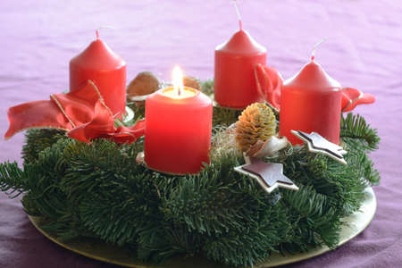 advent wreath: First candle on advent wreath burns as a symbol of preparation for Christmas Stock Photo