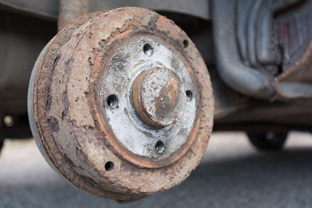 rustiness: Closeup of an old rusty brake drum