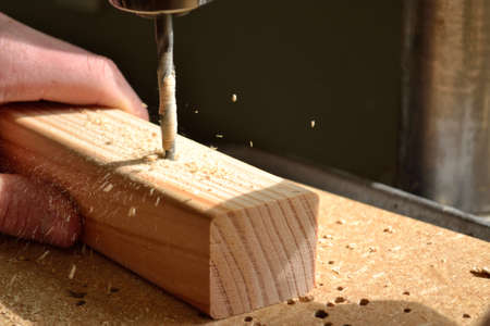 With drill hole is drilled in wood Stock Photo