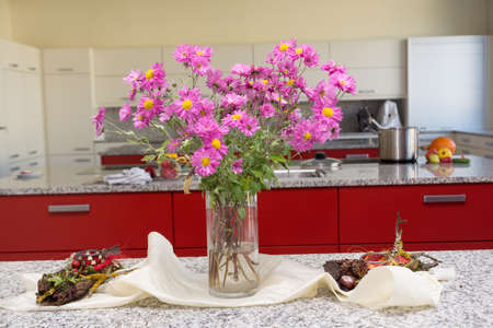 vigorously: vigorously luminous table decoration with asters in the kitchen