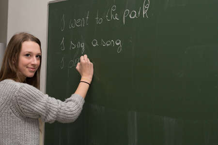 schoolroom: Student writes in the classroom to the school board