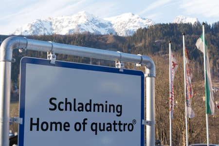 lofty: Signpost the tourist resort Schladming, in the background Dachstein Mountains - austria