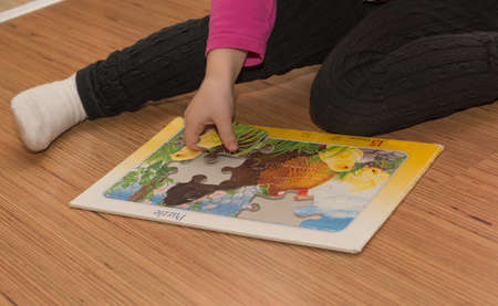 dodgy: Child playing with a puzzle