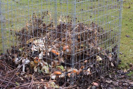 garden waste: Grid composter for garden and kitchen waste Stock Photo