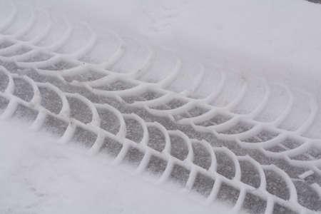 skidmark: Car tire tread in the snow - close-up Stock Photo