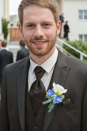 corsage: young groom on their wedding With Corsage and tie