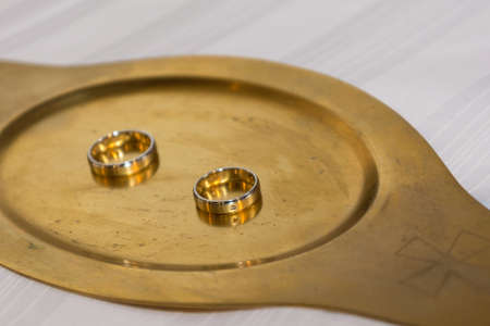 wedlock: Two golden wedding rings on Gold Tablet Stock Photo