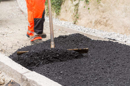 arduous: Sidewalk is just asphalted Stock Photo