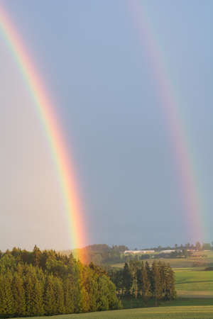 rural area: Double Rainbow at summer storm in rural area Stock Photo