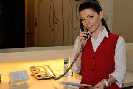 young receptionist phoned guest