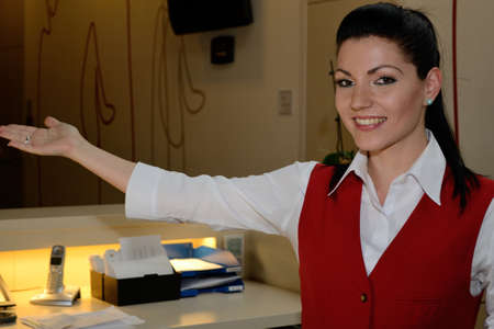jobholder: young receptionist informed guest about Hotel areas - close-up