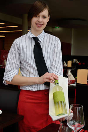 Waitress presenting wine bottle a wine villages