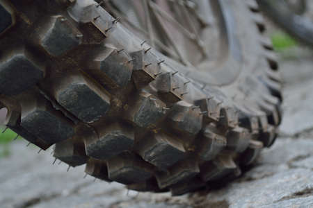 mopeds: Closeup of the tread of a motocross mopeds in lateral position Stock Photo