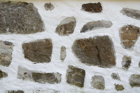damping: Stone facade of an old farmhouse in Upper Austria Stock Photo