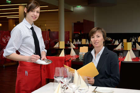 jobholder: young Restaurant Assistant listed order of the guest