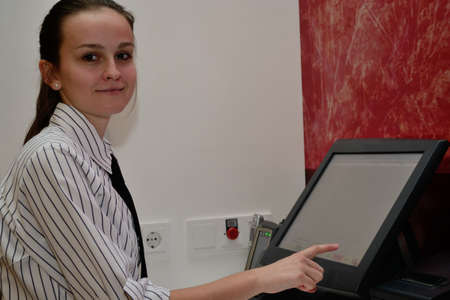 jobholder: young Restaurant woman prints on PC invoice for buyer