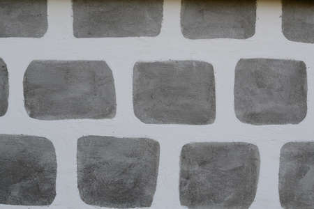 damping: painted patterning a stone facade of a farmhouse