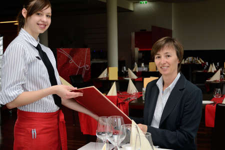 Hotel assistant presented to the guest the wine list
