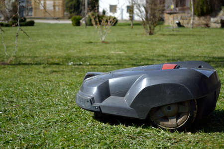 Lawnmower robot ensures independently for manicured lawns Stock Photo
