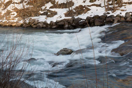 runnel: soft flowing water in a stream in winter Stock Photo