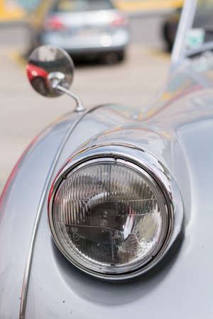 rear view mirror: flivver - headlights and rear view mirror of a classic car at a glance Stock Photo