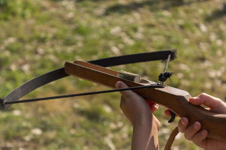 finger on trigger: Marksmanship with a crossbow Stock Photo