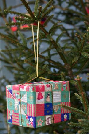 christmasy: Gift hanging on Christmas tree Stock Photo