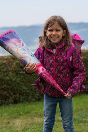 cornet: Smiling schoolchild with satchel and cornet
