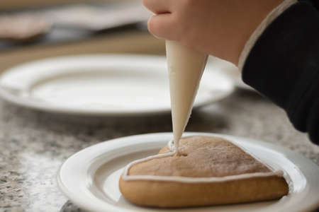 bickie: Gingerbread is decorated with icing Stock Photo