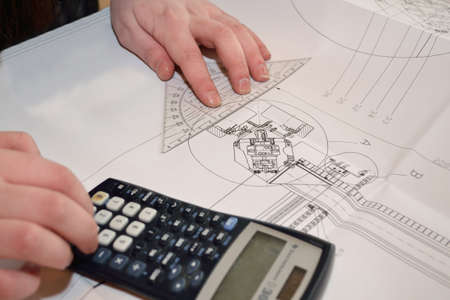 calculated: Person calculated and measured technical drawing - close-up