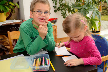 children painting: Two children while painting Stock Photo