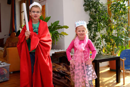 boyhood: Two children dressed as King and Princess Stock Photo