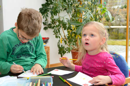Two children while painting Stock Photo