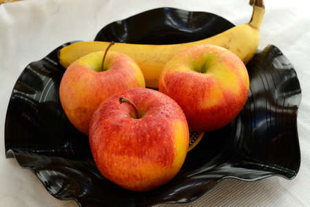 fruit bowl: Banana and apples in a fruit bowl shaped to record