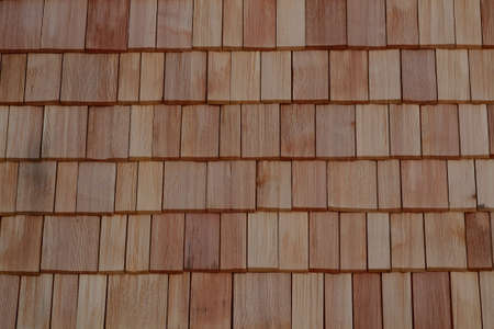 damping: house wall with wooden shingles