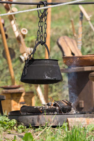 madhouse: In saucepan over your campfire food is cooked - cauldron Stock Photo
