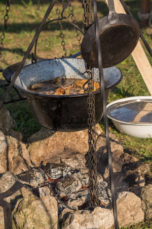 madhouse: In saucepan boils over your campfire tasty food Stock Photo