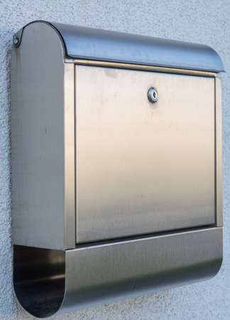 reachability: Modern post box made of metal with paper roll Stock Photo