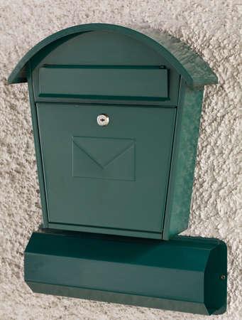 lockbox: bright green postbox and newspaper holder