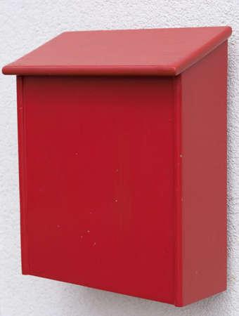 lockbox: bright red post box made of wood Stock Photo