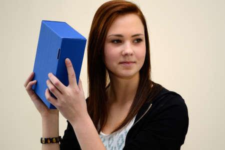 blue box: Teenager shakes sealed blue box Stock Photo