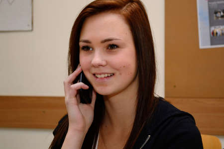 telephoning: friendly teenager when telephoning