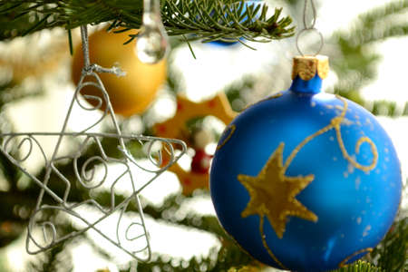 festively: Christmas baubles and star - Christmas tree decorations Stock Photo