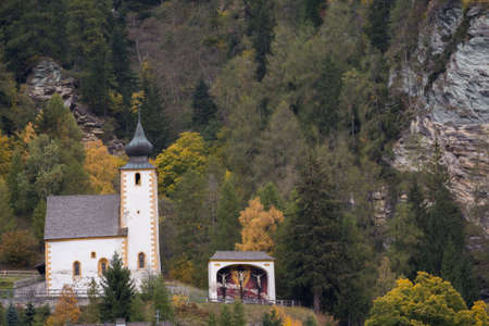 totaled: featured small church in front of a mountain - Salzburg, Austria