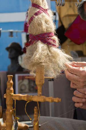 craftsmanship: Turn on flax spinning wheel - Person at old craftsmanship