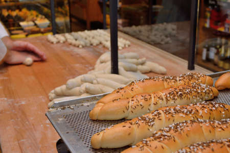 pretzel stick: Bakers in the bakery shaped pastries