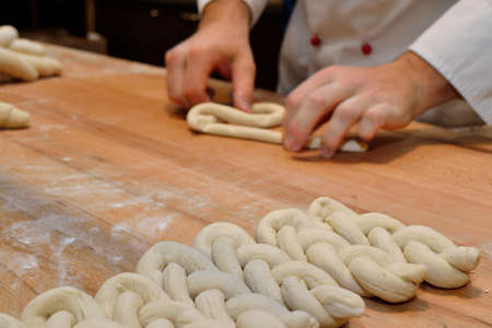 pretzel stick: Bakers in the bakery with dough
