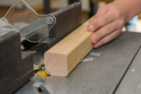 exactness: Carpenter working with cutter